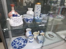 2 shelves of mainly blue and white china to include bowls and vases
