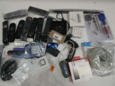 Bag containing remote controls, watch repair kit, smart watch, cabling, adapters etc