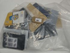 Bag containing quantity of various tablet cases