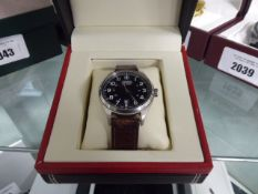 Wenger Swiss military wristwatch with black dial and brown leather strap in box