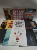 Box containing LP and 45 records to include Jackson 5, Beatles, Metallica, Bob Marley, Liam