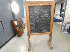 Pine menu board with racks and cupboard to rear