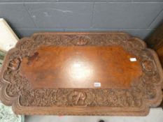 Heavily carved Siamese table with elephant floral and dragon pattern