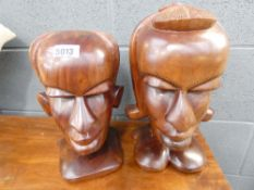 Pair of carved African male and female heads