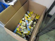Box containing various Tetra aqua safe chemicals and Tetra fish flakes