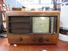Vintage radio in walnut case
