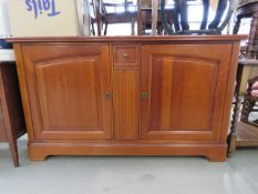Cherry finished side board with 2 doors under