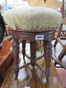 Carved adjustable Edwardian piano stool