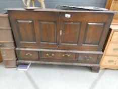 Oak double door cabinet with 3 drawers under