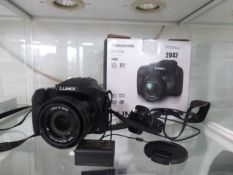 Panasonic DC-FZ82 4K bridge camera with charging adapter, battery and box