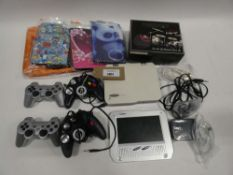 Bag containing portable DVD player, Goodmans Game & Play controllers, tablet cases etc