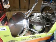 Tray containing stainless steel Kirkland pots and pans
