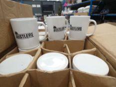 Box containing Rustler's drinking mugs