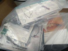 Bag containing sun reading glasses, teeth whitening kit, etc