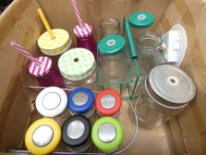 Box containing various sized glass jars