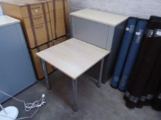 A maple top and grey tambour unit with pedestal under, plus a similar maple top square table