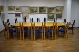 A 1983 conference suite in sweet chestnut including a twin pedestal table, 382 x 177 cm,