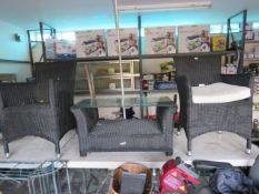 Black rattan patio set comprising 2 armchairs and glass top side table