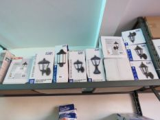Shelf containing boxed outdoor LED coach lantern wall lights in mixed sizes