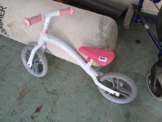 Childs balance bike in pink and white