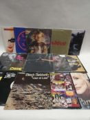 Box containing LP and 45 records to include Bob Marley & The Wailers, Black Sabbath, Pink Floyd,