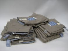 Bag containing 15 pairs of Soccer Khaki gents trousers size ranging from 32'' waist - 40'' waist -