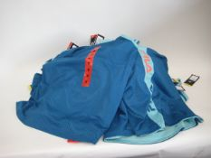 Bag containing 26 ladies Fila mesh overlay tank tops in turquoise and blue