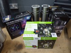 Box of colour changing LED lights, Sunforce solar sting lights, and Artika post lights