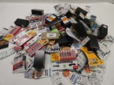Bag containing quantity of batteries in various sizes
