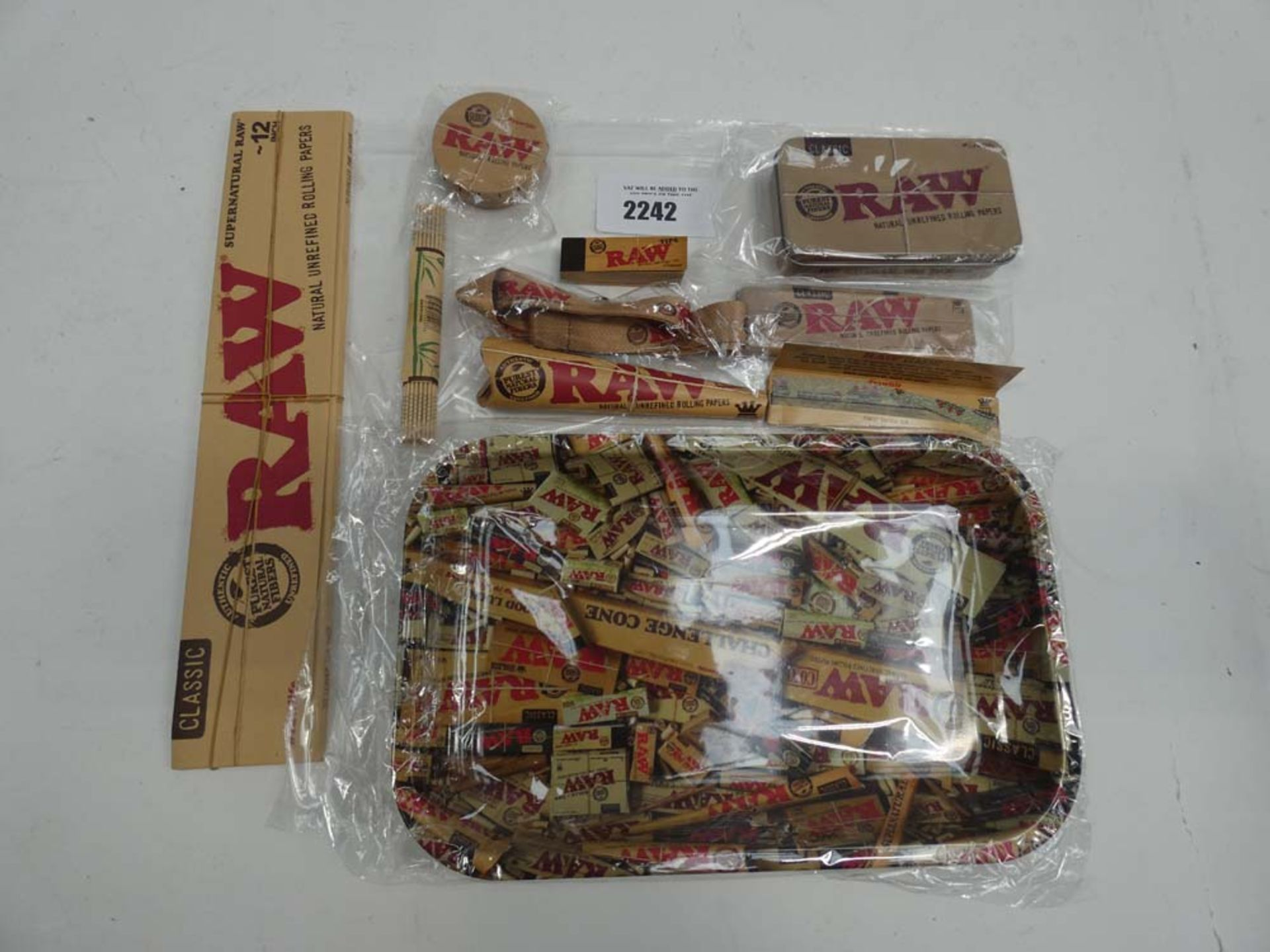 Quantity of RAW smoking accessories; tray, tin, smoking papers and card tips