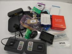 Bag containing routers, alarm kits, NowTV stick, mice, etc