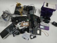 Bag containing routers, BT 4G Assure dongles, PC mouse and other electrical related accessories