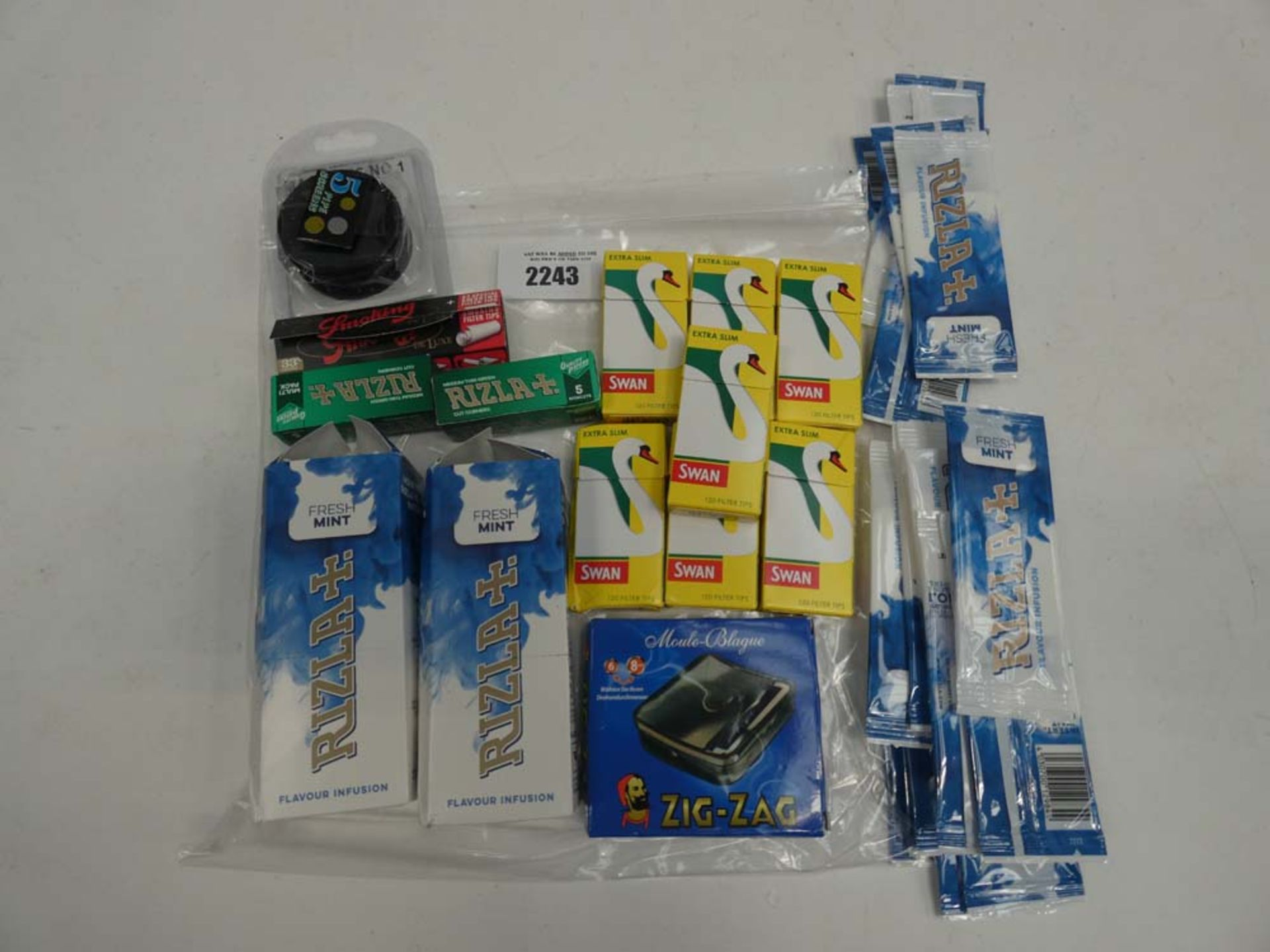 Quantity of mixed smoking accessories; Swan filters, Rizla flavour infusions, smoking papers,