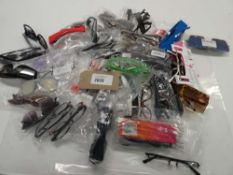 Bag containing various loose sunglasses and reading glasses