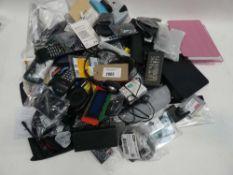 Bag containing mixed electronics incl. headphones, remote controls etc.