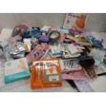Large bag of beauty products including makeup & hair brushes, perfume & sample sachets, hair