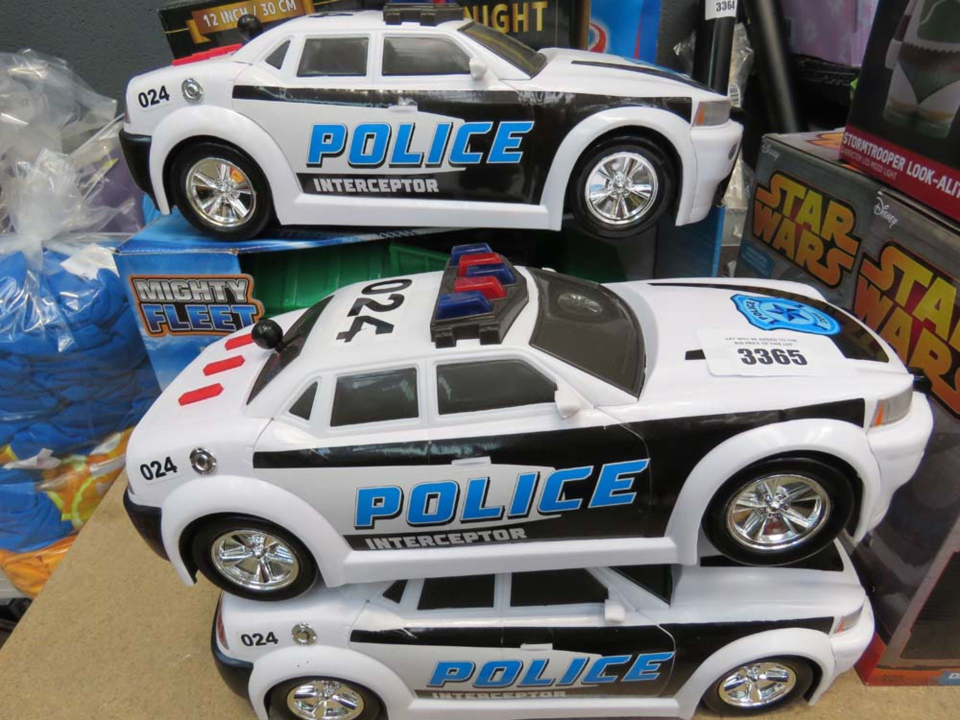 3 toy police cars and bin lorry