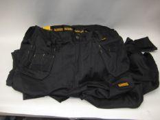 Bag containing 10 Dewalt work trousers sizes mainly 38'' waist, 32'' leg
