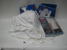 Bag containing white t-shirts by Champion, Kirkland and Nautica in various sizes