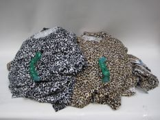Bag containing ladies tops in an animal print, 20 in a natural leopard print and 4 in a black