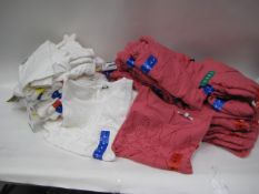 Bag containing 28 pink blouses sizes M-XL together with 32 white ladies blouses sizes S-XL