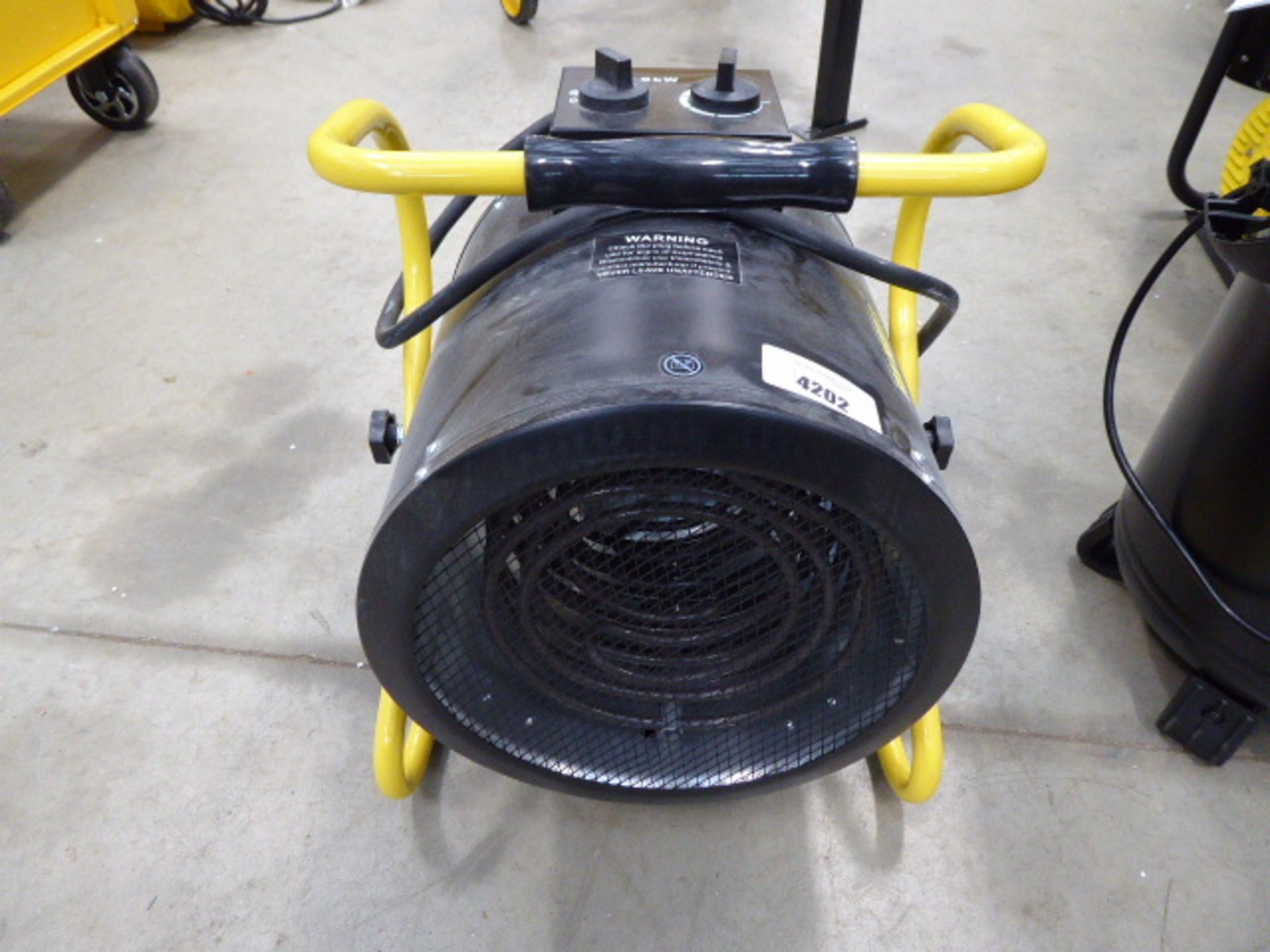 Large black and yellow fan heater