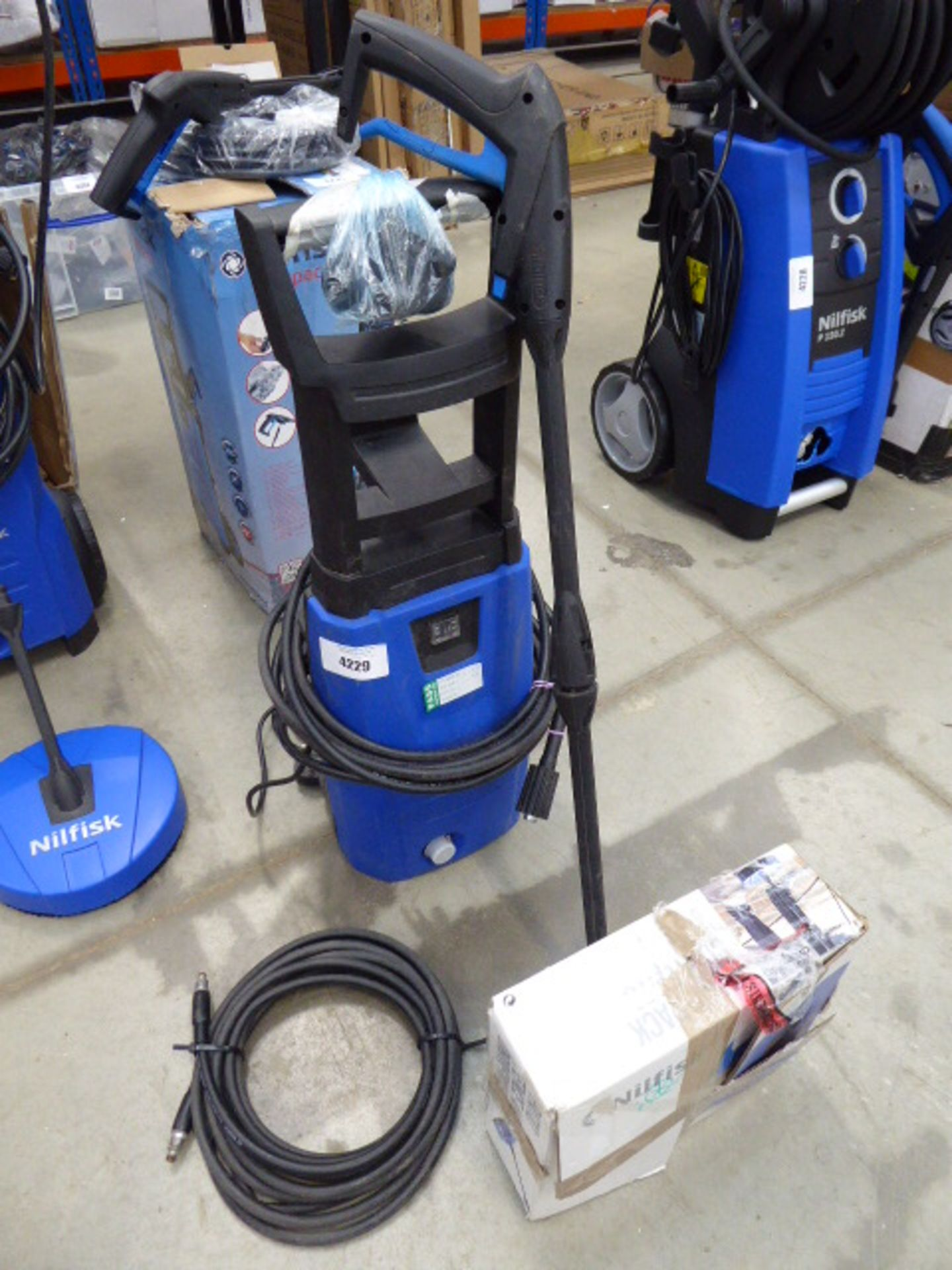Small Nilfisk pressure washer with patio cleaning head