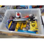 Large box containing security locks, cable access kit, grease gun, hatchet, adhesive, etc