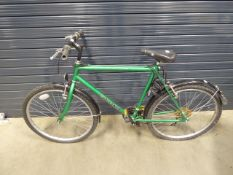Green gents mountain bike with a quantity of spare tyres and wheel
