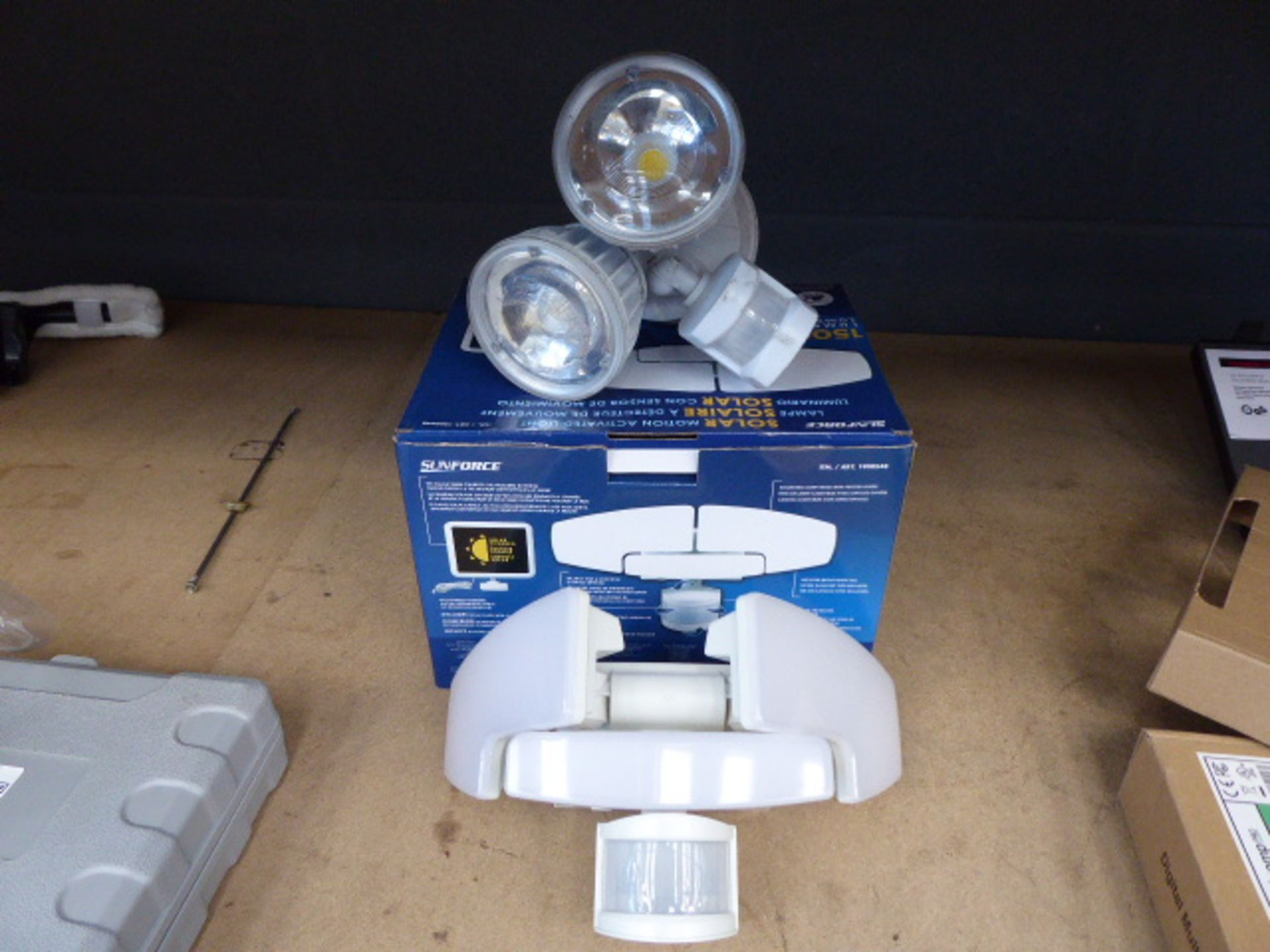 2 solar motion lights (1 boxed, 1 unboxed)