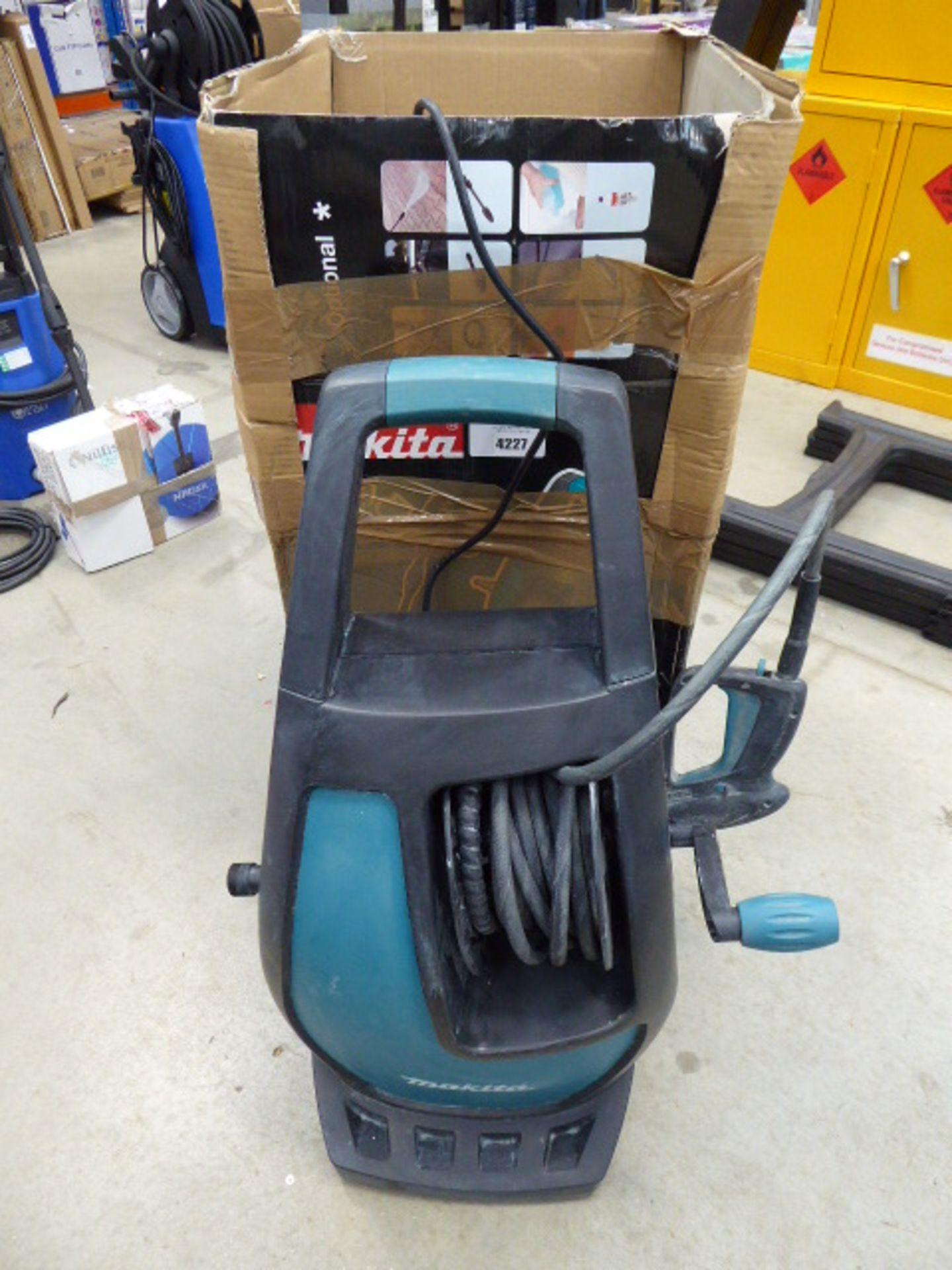 Boxed Makita electric pressure washer