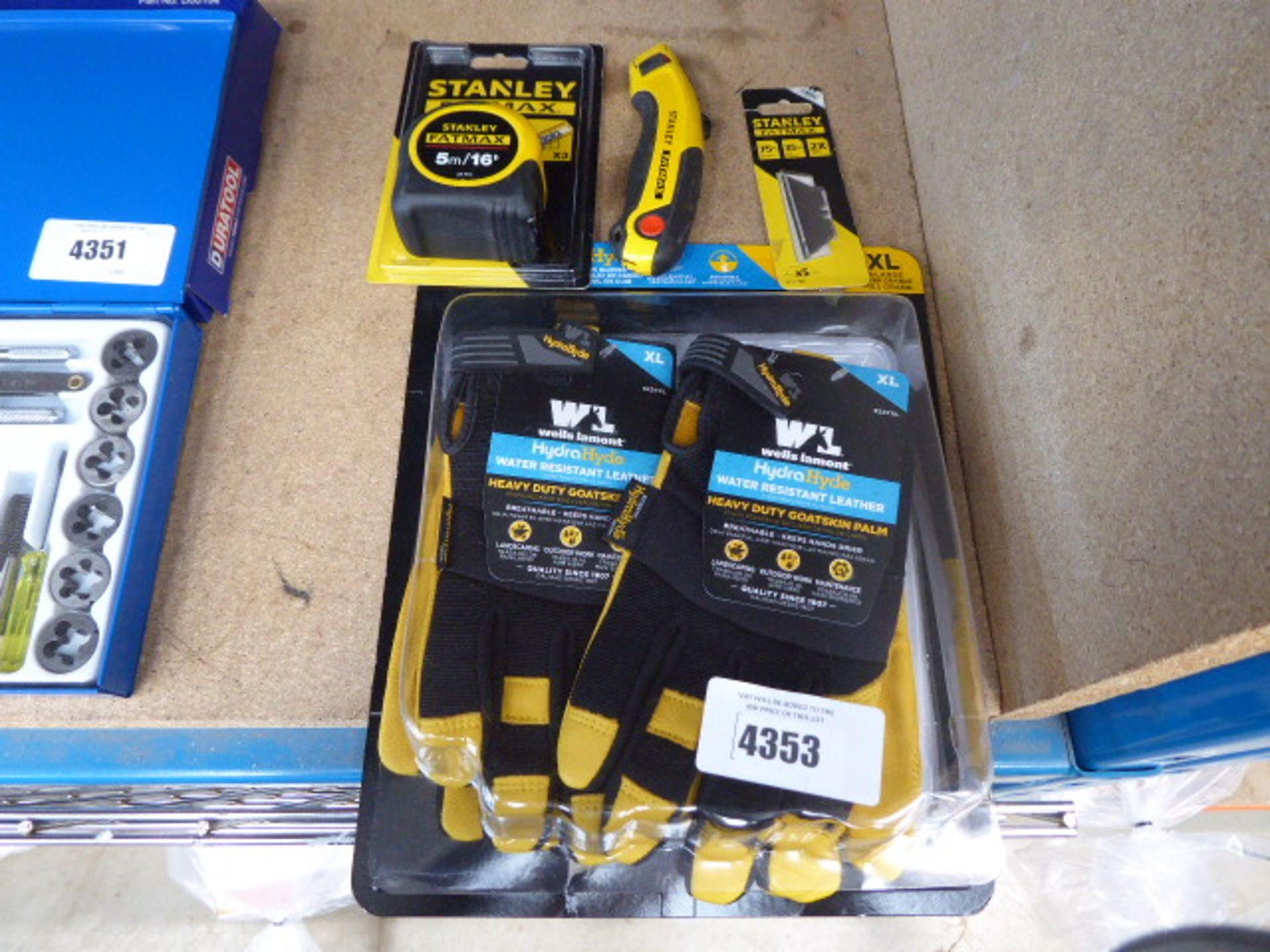 Stanley tape measure, knife, work gloves, golfing gloves and some LED mini lights