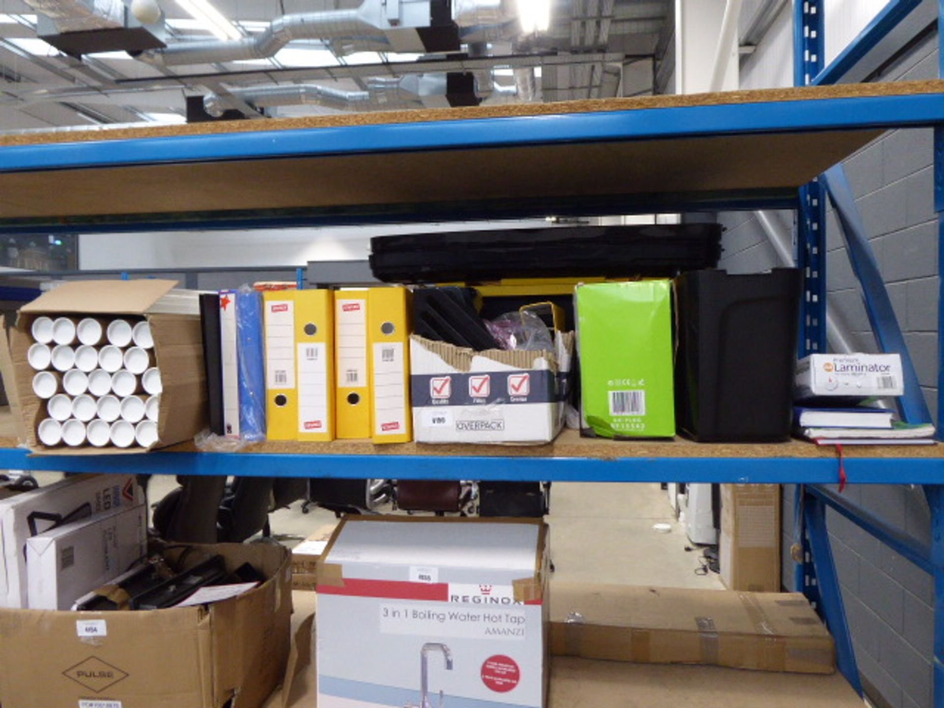 Half shelf of assorted stationary