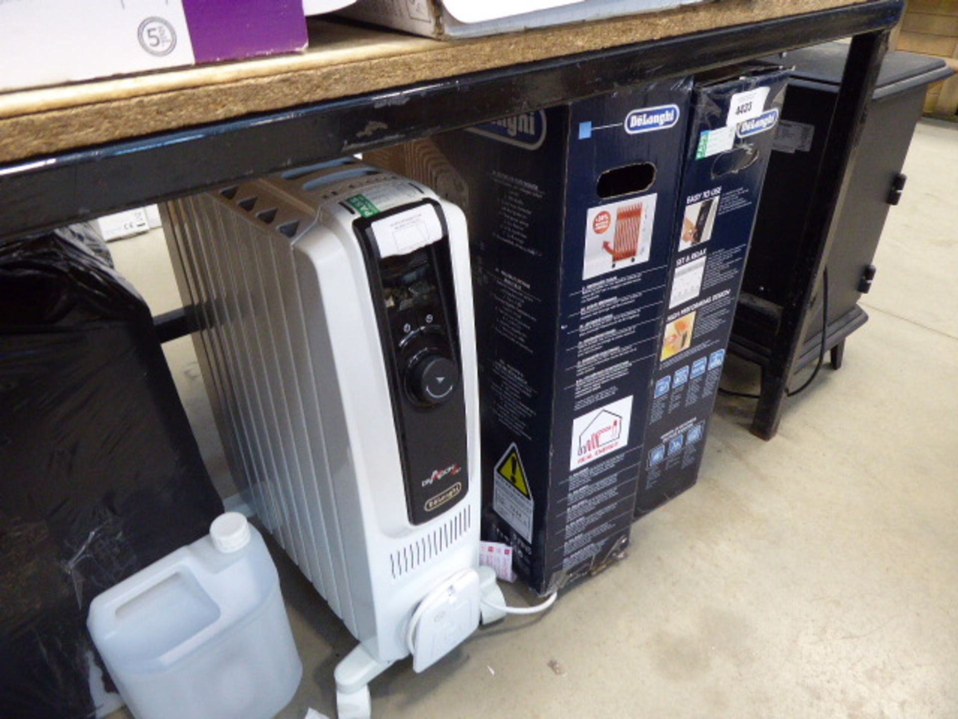 3 De'Longhi oil filled radiators (2 boxed, 1 unboxed)